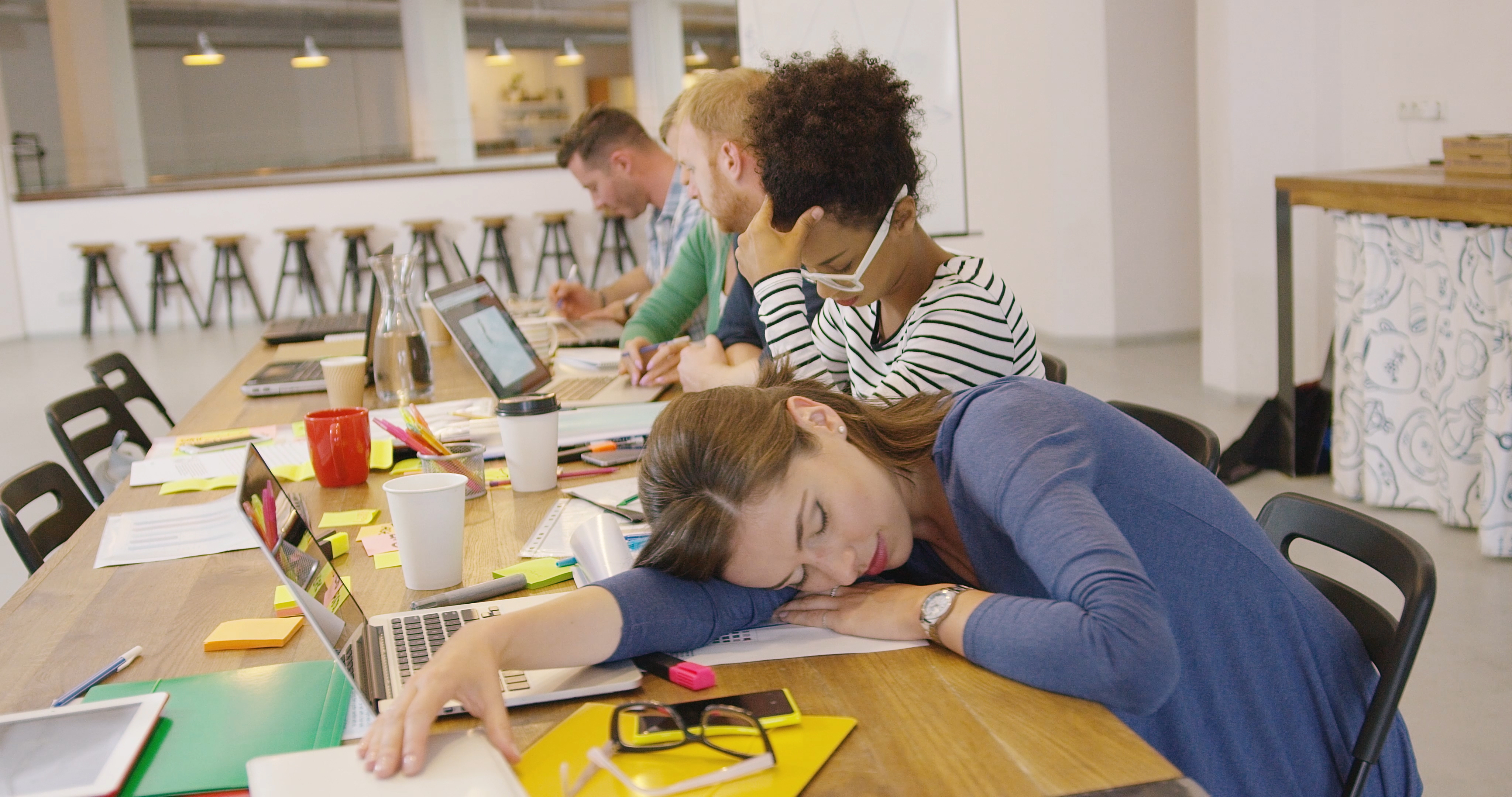 Tired worker at table in office – The Parallax Partnership